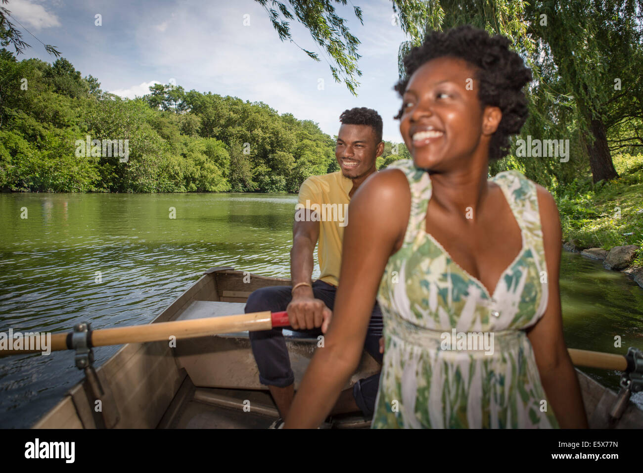 Young couple in rowing boat on lake in Central Park, New York City, USA Stock Photo