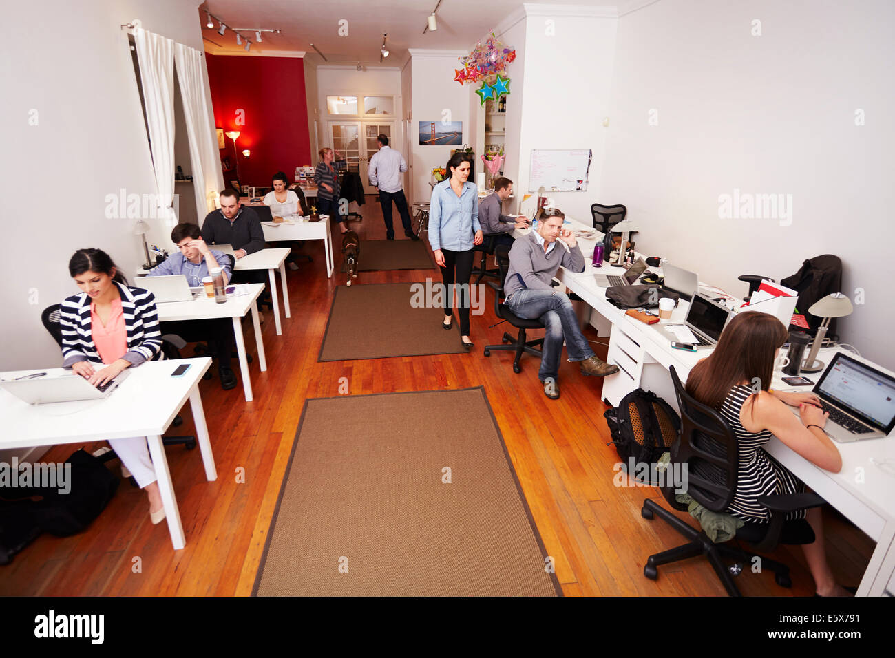 People at work in busy modern office - Stock Image