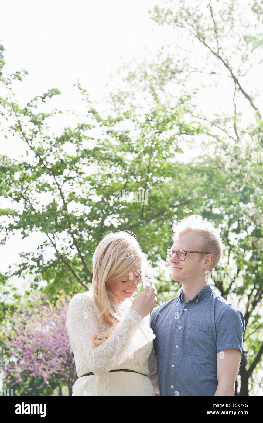 Young couple in park Stock Photo