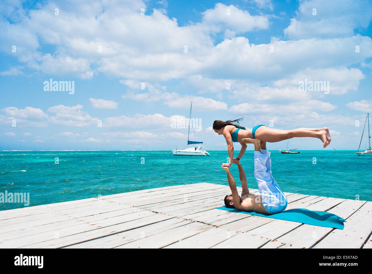 Young couple in airplane pose on pier, San Pedro, Belize - Stock Image