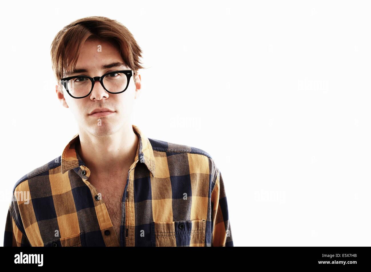 Studio portrait of young man in eyeglasses Stock Photo