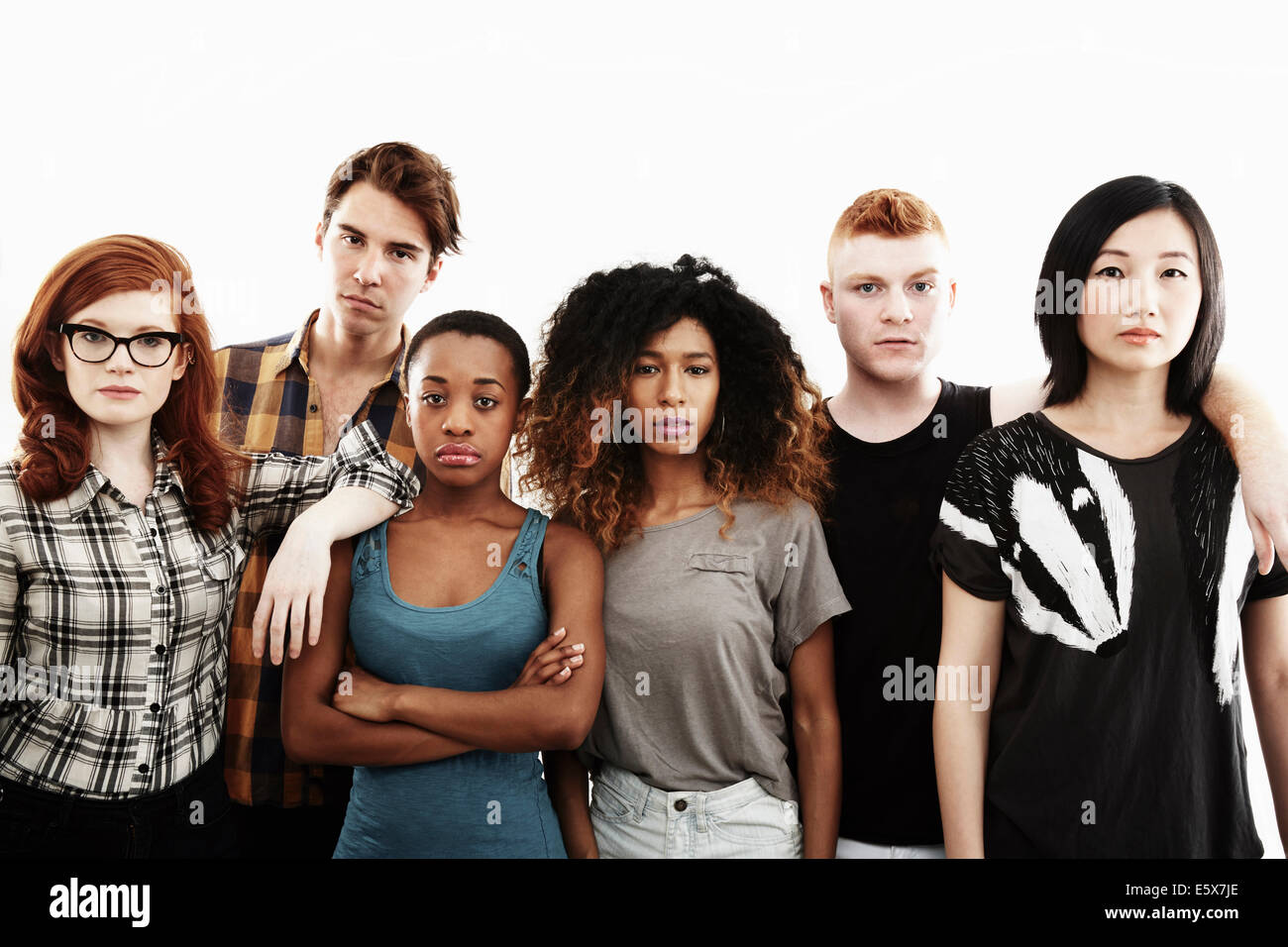 Formal studio portrait of six serious young adults - Stock Image