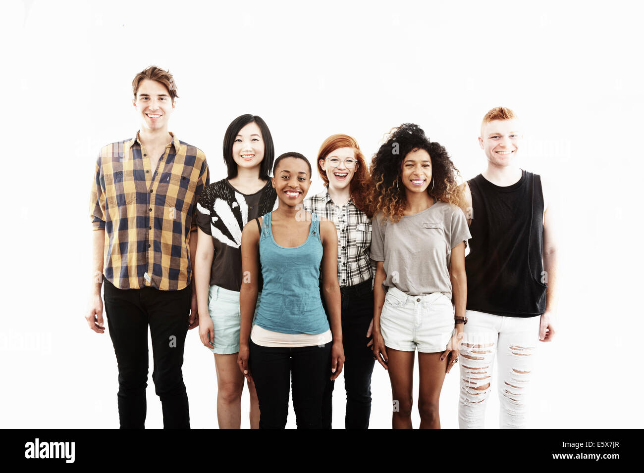 Formal studio portrait of six young adult friends - Stock Image