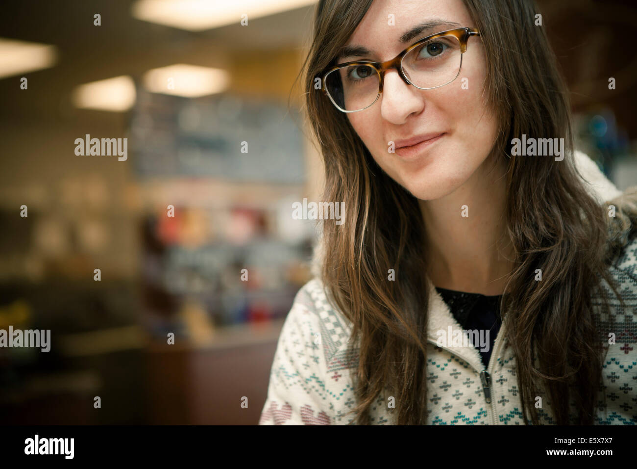 Close up portrait of mid adult woman in cafe - Stock Image