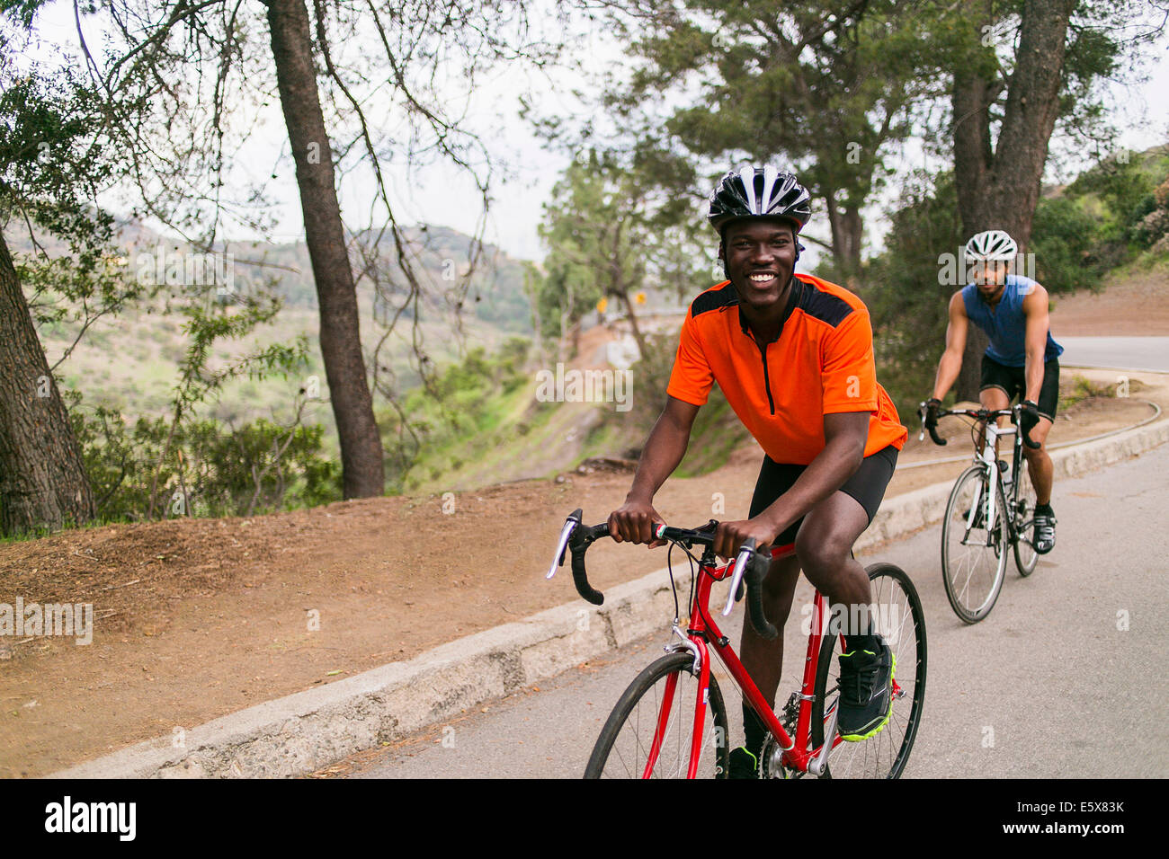 Cyclists on uphill road - Stock Image