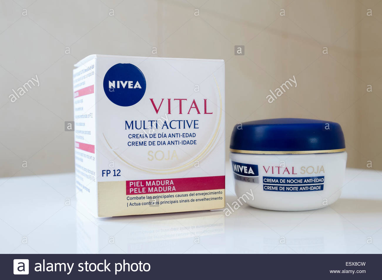 a pot of Nivea anti-age moisturising night cream with a box containing a pot of day cream from the same range, as - Stock Image