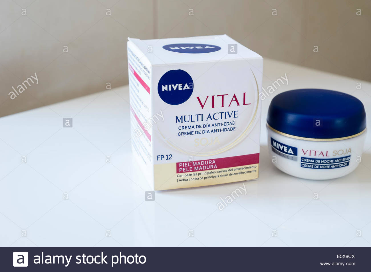 a pot of Nivea anti-age moisturing night cream with a box containing a pot of day cream from the same range, as - Stock Image