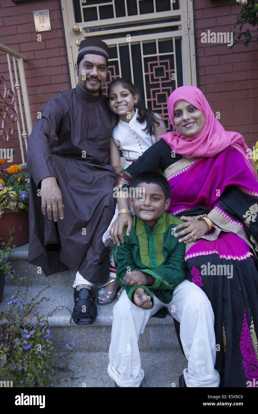 Bangladeshi American family dressed up for the Muslim holiday Eid at the end of Ramadan. - Stock Image