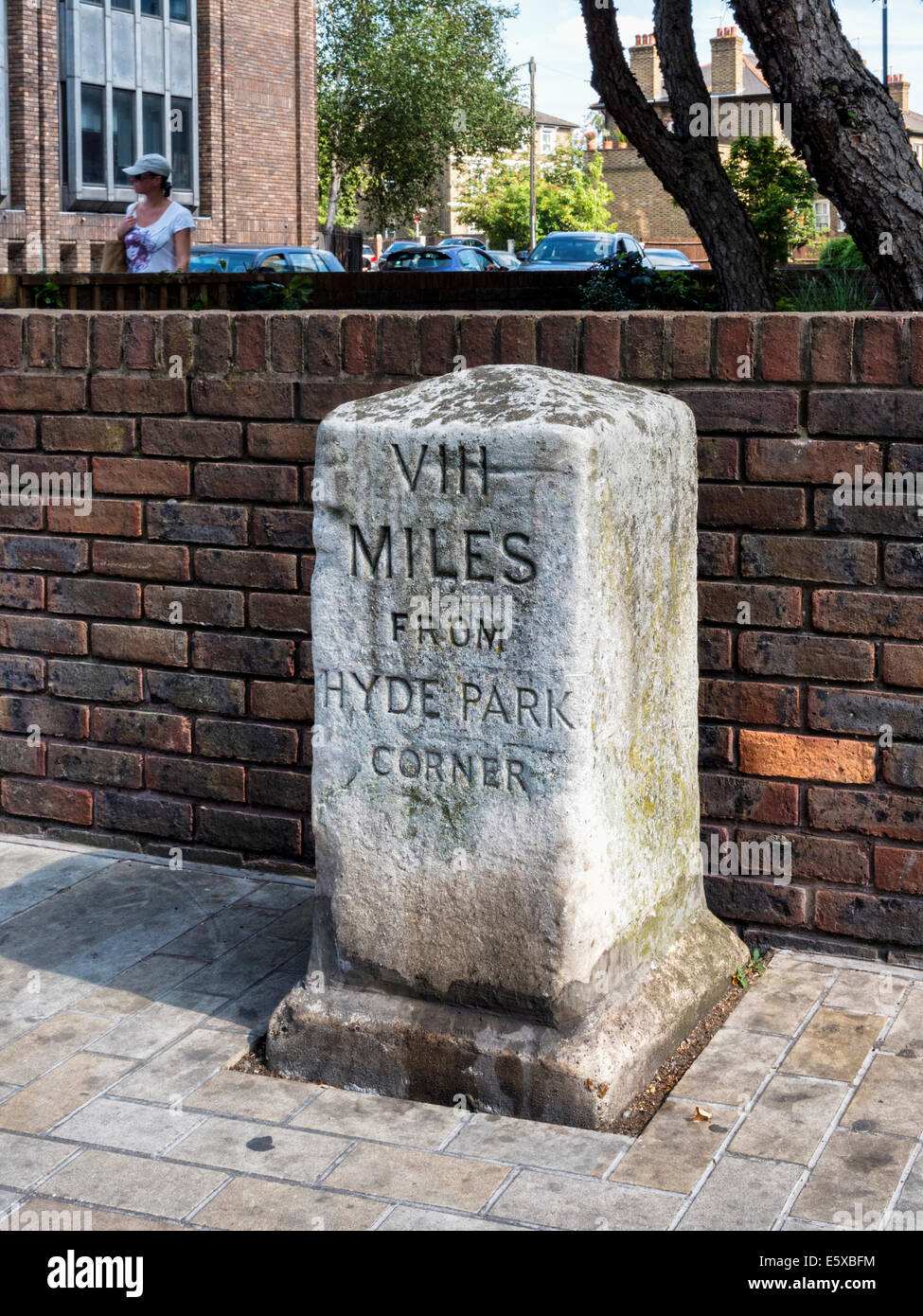 Richmond upon Thames, Surrey, London TW9 - Weathered old milestone with 'Vlll Miles from Hyde Park Corner Inscription' - Stock Image