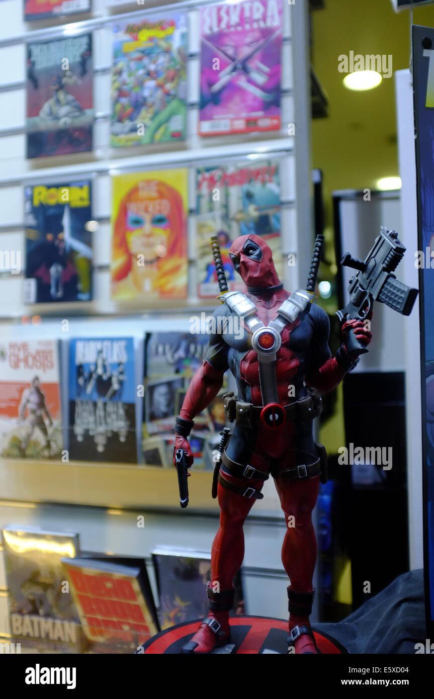 Comic super villain figure in Scifi shop window - Stock Image