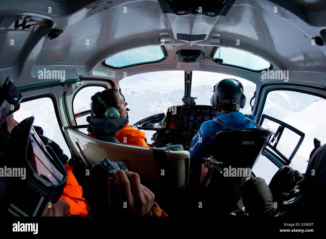 Flying Chugach Powder Guides Helicopter, Girdwood, Alaska. - Stock Image