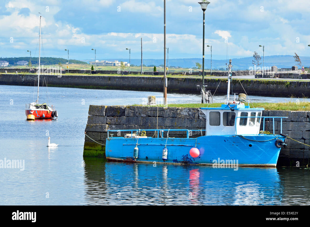 Boats moored at the seaward end of the Claddagh Basin, the old harbour area of Galway city. - Stock Image