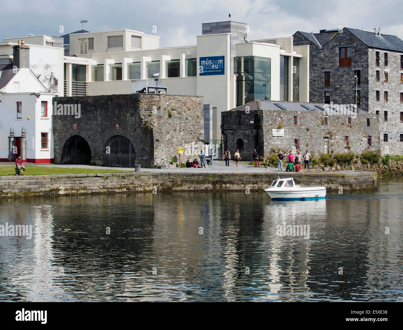 Pleasure boats in the Claddagh Basin, the old Galway town harbour with the Spanish Arches and modern museum building. - Stock Image
