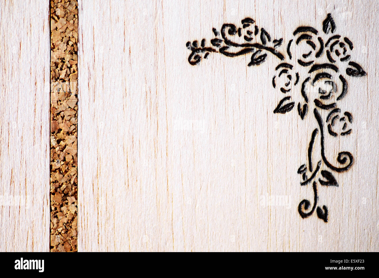 A a floral model made with pyrography on wood Stock Photo