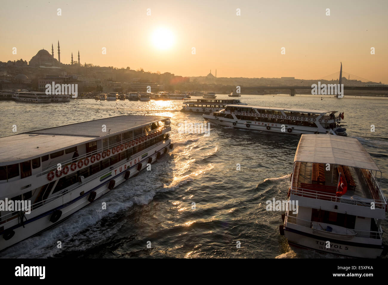 Passenger ships floating on the Golden Horn as the Yavuz Sultan Selim Cami stands out in the horizon in Istanbul, - Stock Image