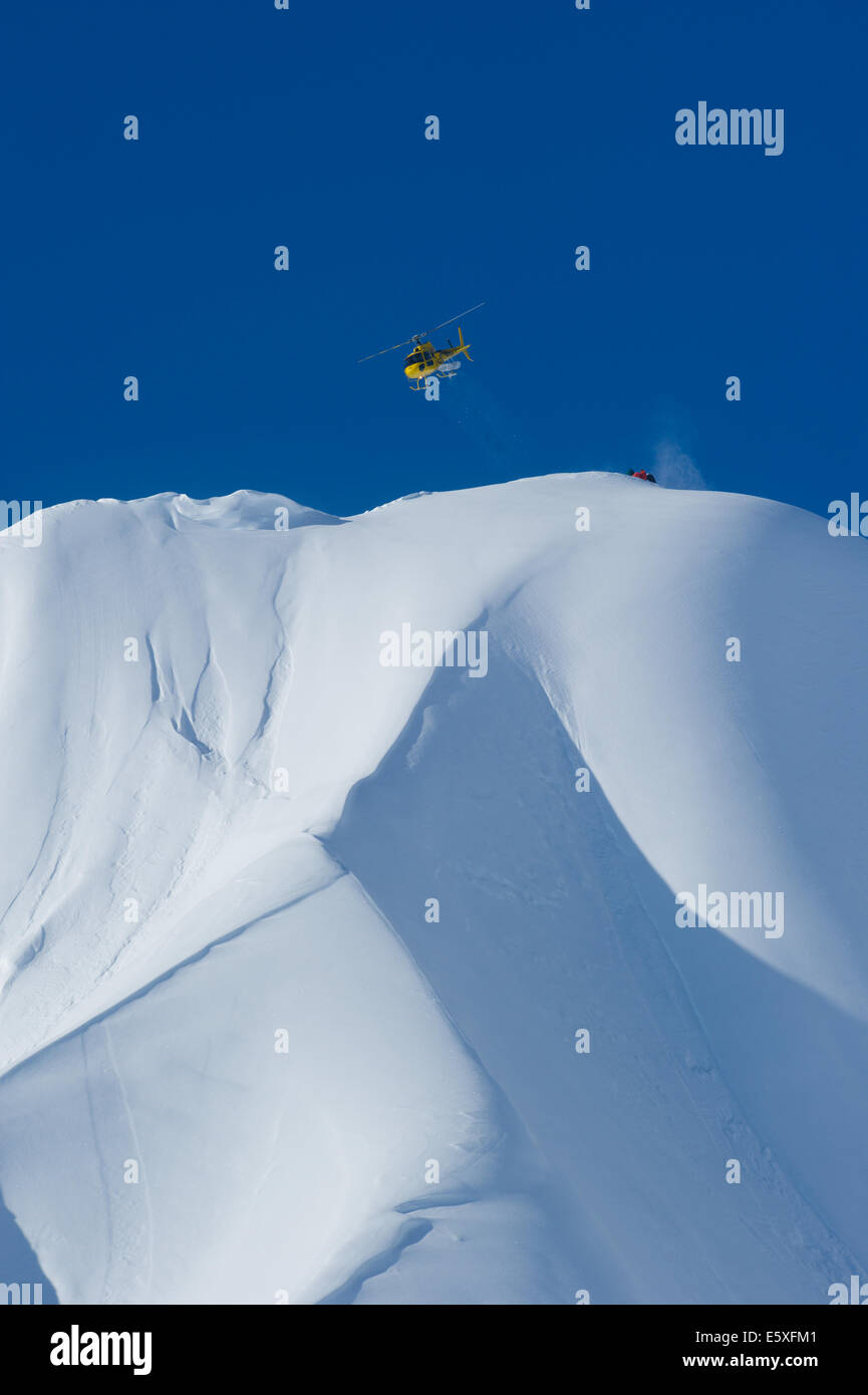 A helicopter flying over the mountains of Haines, Alaska - Stock Image