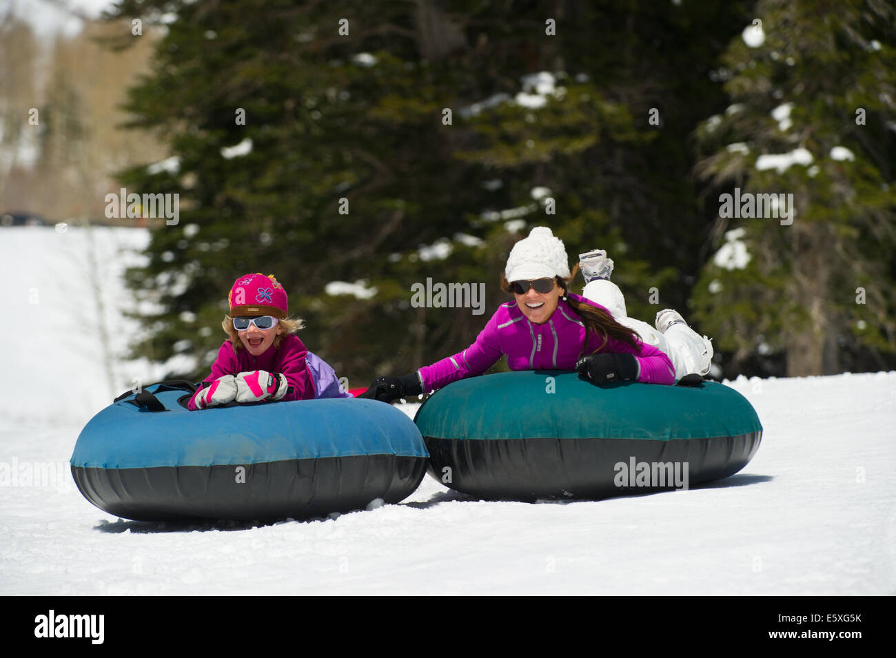 Suzanne and Lucy Weiss enjoy their time tubing at Snowbird Resort in Utah. - Stock Image