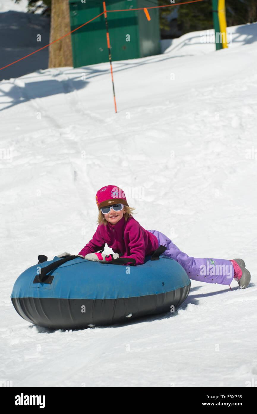 Lucy Weiss enjoys tubing at Snowbird Resort in Utah. - Stock Image
