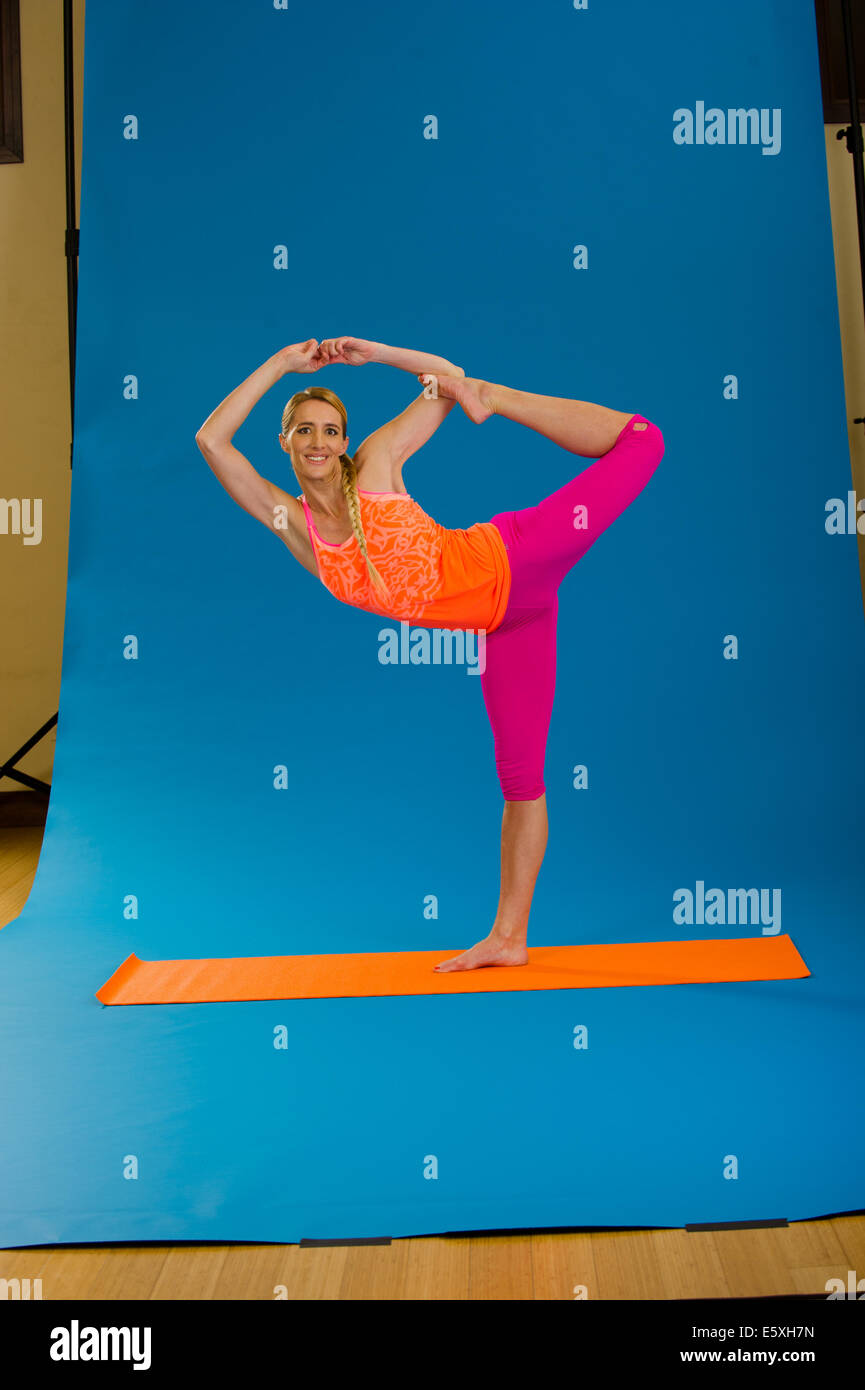 Cindi Terry practices her yoga moves at a studio in Heber, Utah - Stock Image
