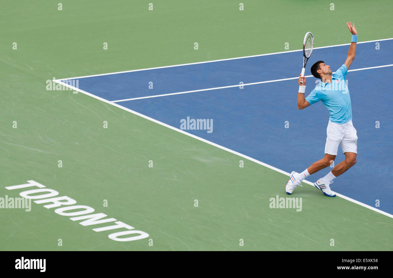 Toronto, Canada. 07th Aug, 2014. Novak Djokovic of Serbia serves during the third round of men's singles against - Stock Image