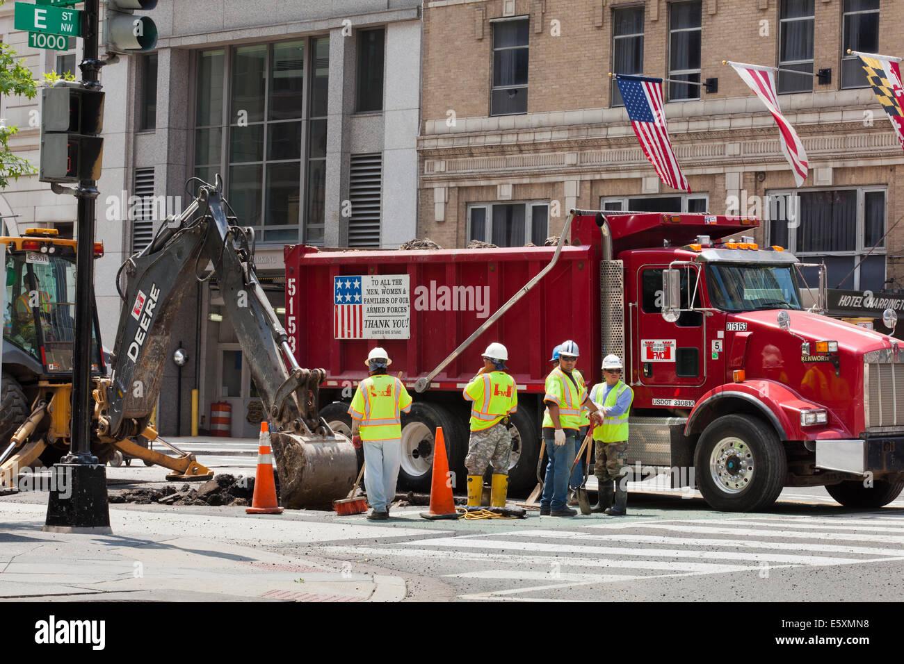 Municipal utility construction crew working on road - Washington, DC USA - Stock Image
