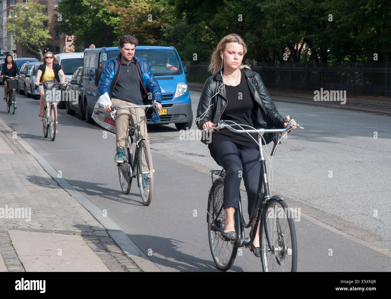 Cyclists riding down Gothersgade in Copenhagen - Stock Image