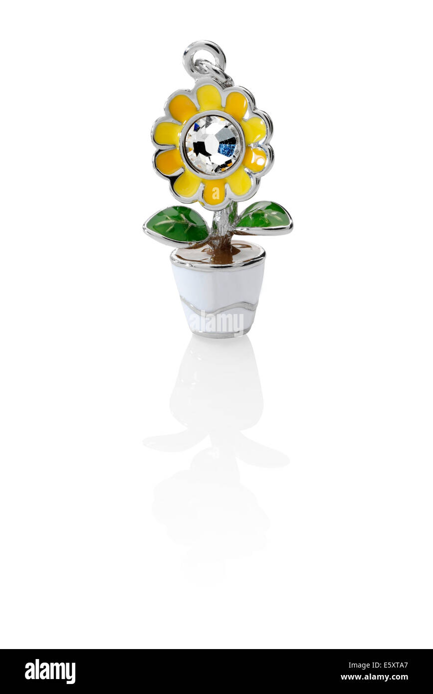 Flower in pot jewelry charm - Stock Image