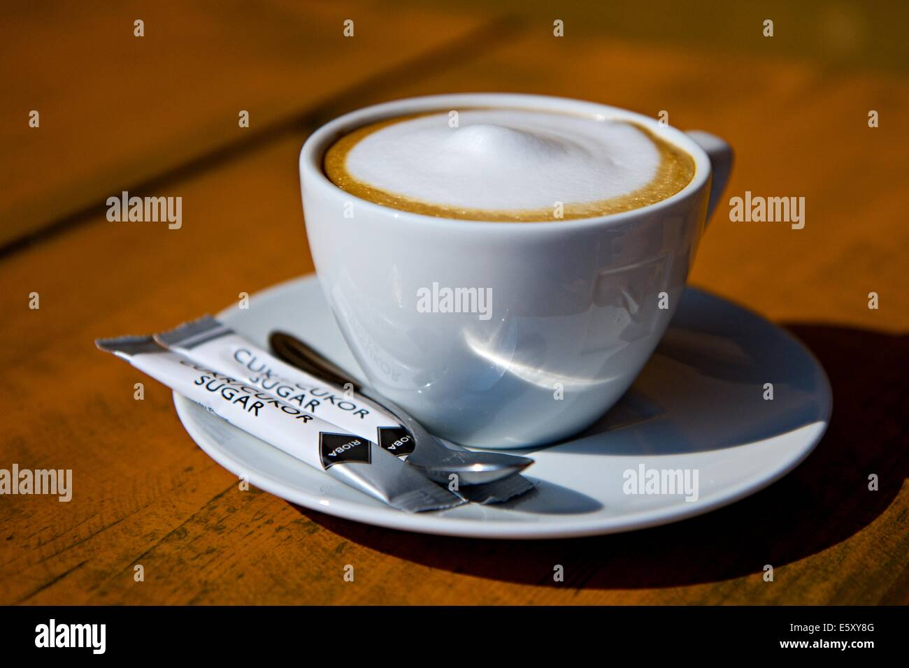 cup of cappuccino on a wooden table - Stock Image