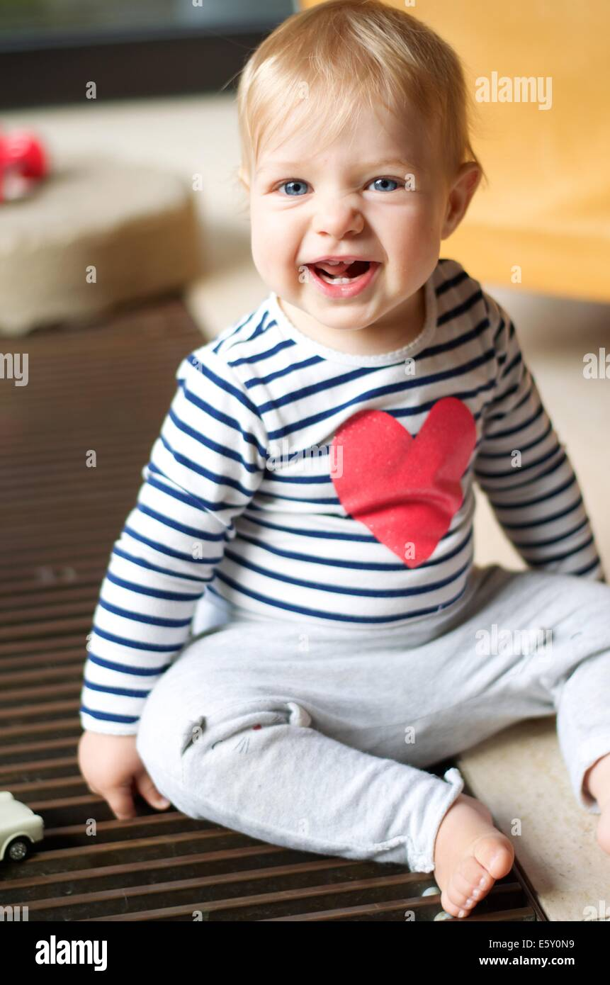 cute toddler with characterful grin - Stock Image