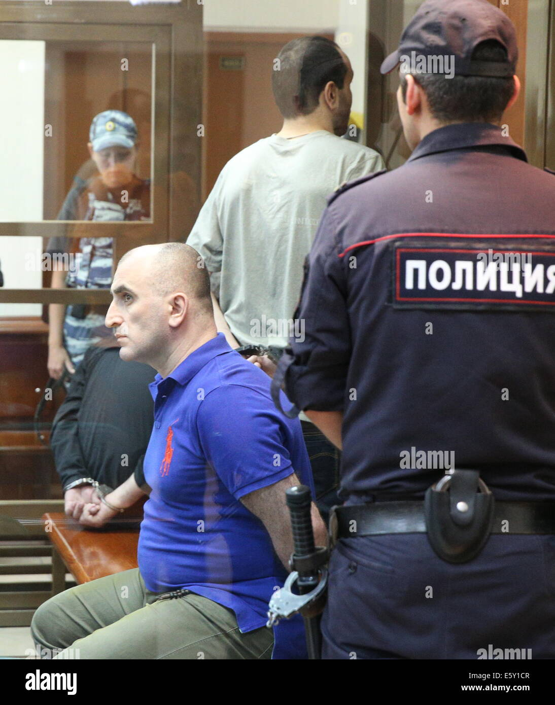 Moscow, Russia. 7th Aug, 2014. Alexander Berishvili (seated) appears in a Moscow court during hearings in the murder - Stock Image