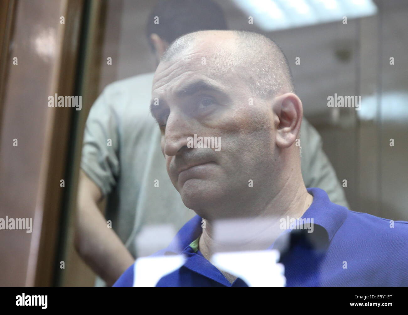 Moscow, Russia. 7th Aug, 2014. Alexander Berishvili appears in a Moscow court during hearings in the murder of Georgian - Stock Image