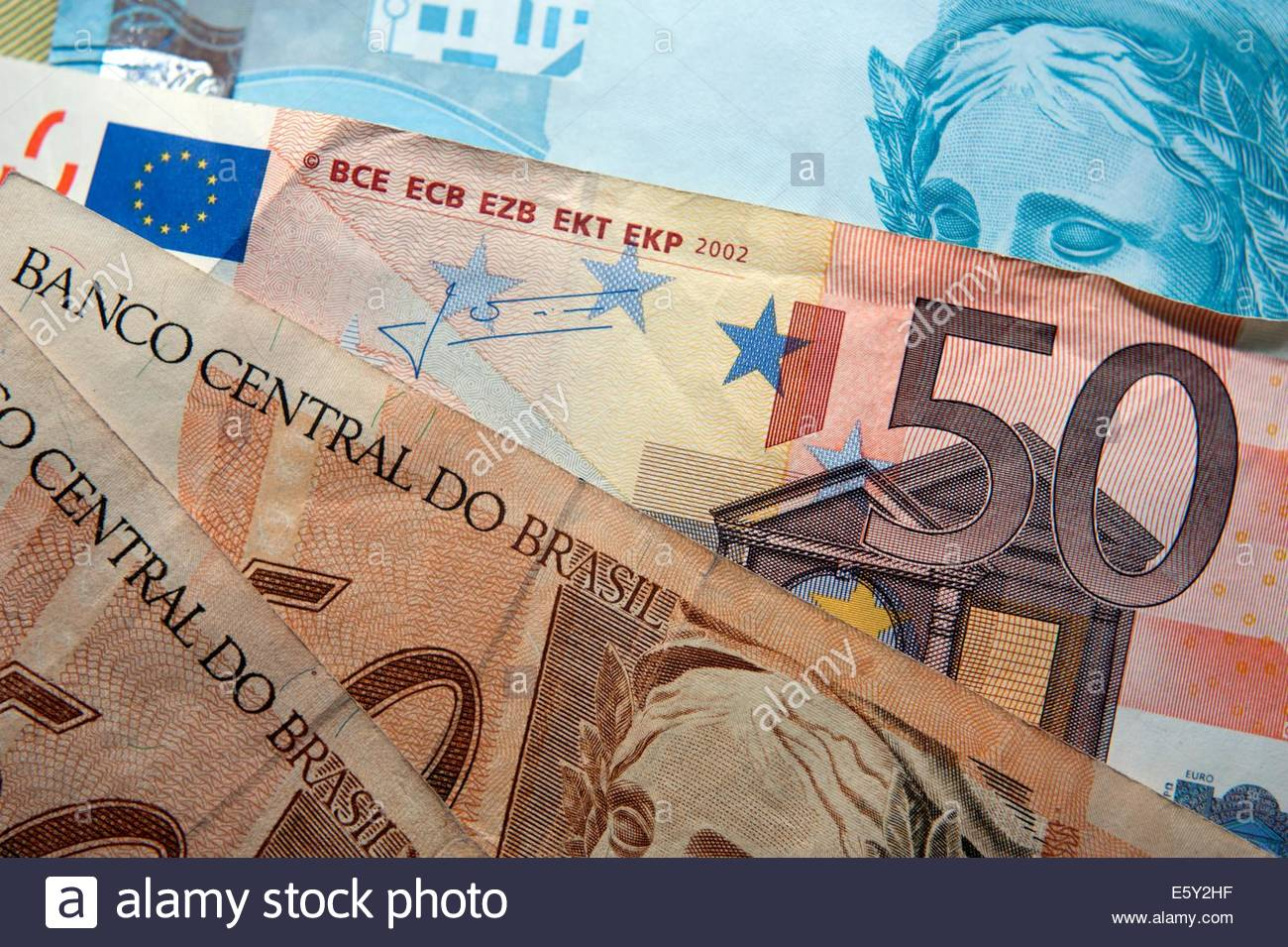 Brazilian Reals currency with Euro's. - Stock Image