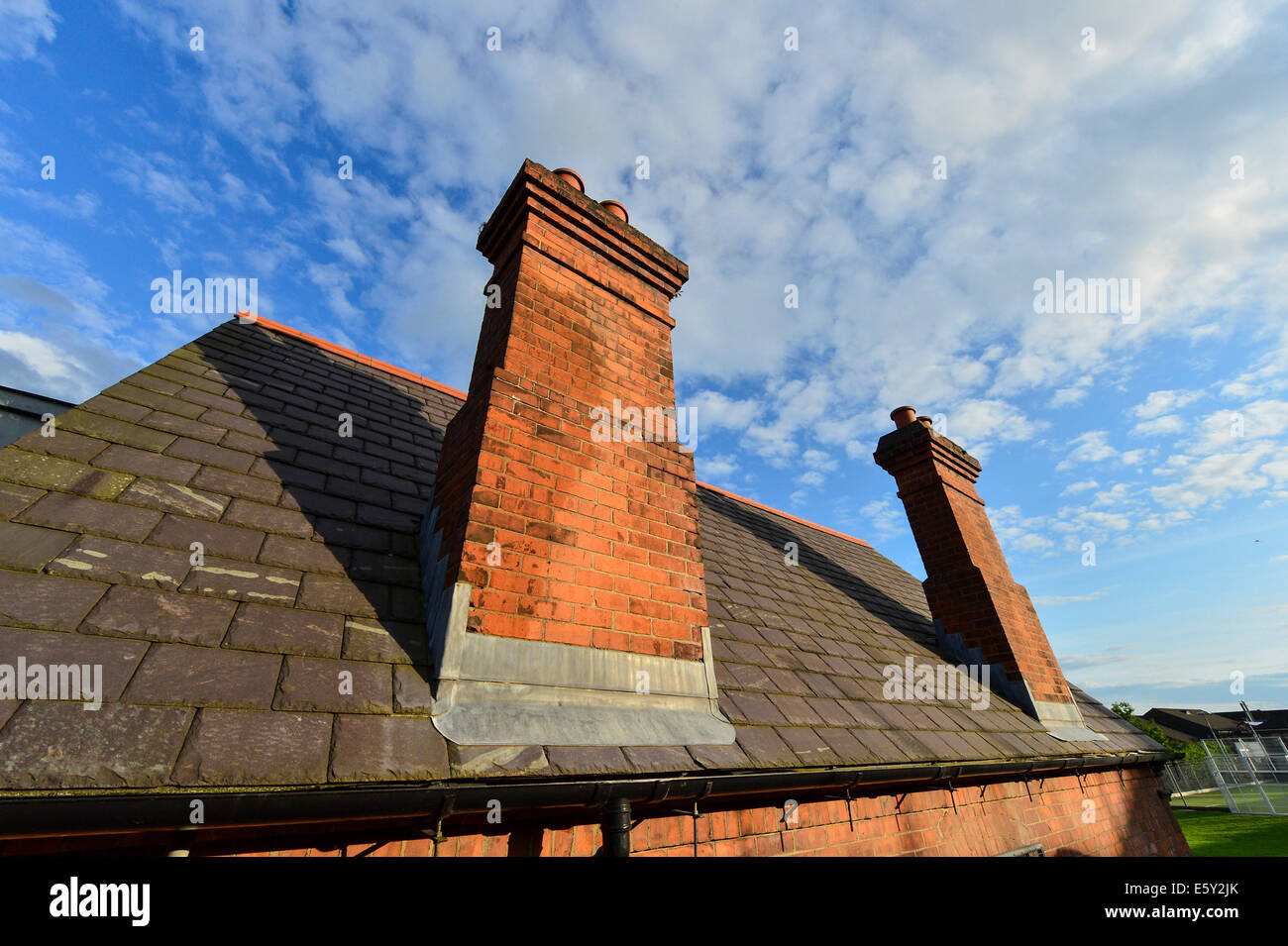 Tall Red Brick Solid Fuel House Chimney And Blue Sky, Derry, Londonderry,  Northern