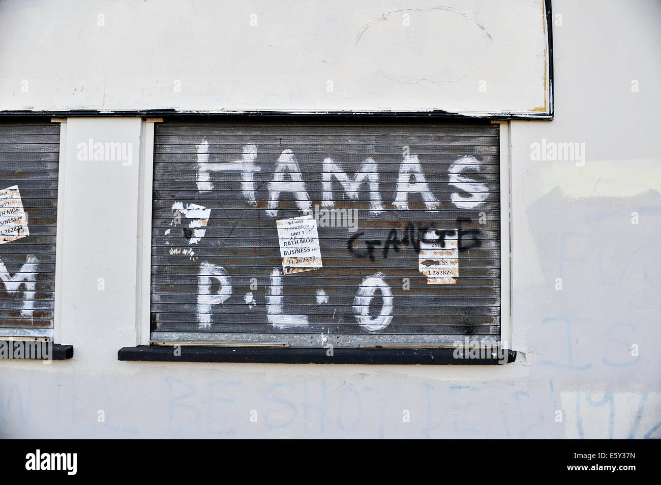 Graffiti supporting Hamas and PLO painted on shop shutters in Bogside, Derry, Londonderry, Northern Ireland. Stock Photo