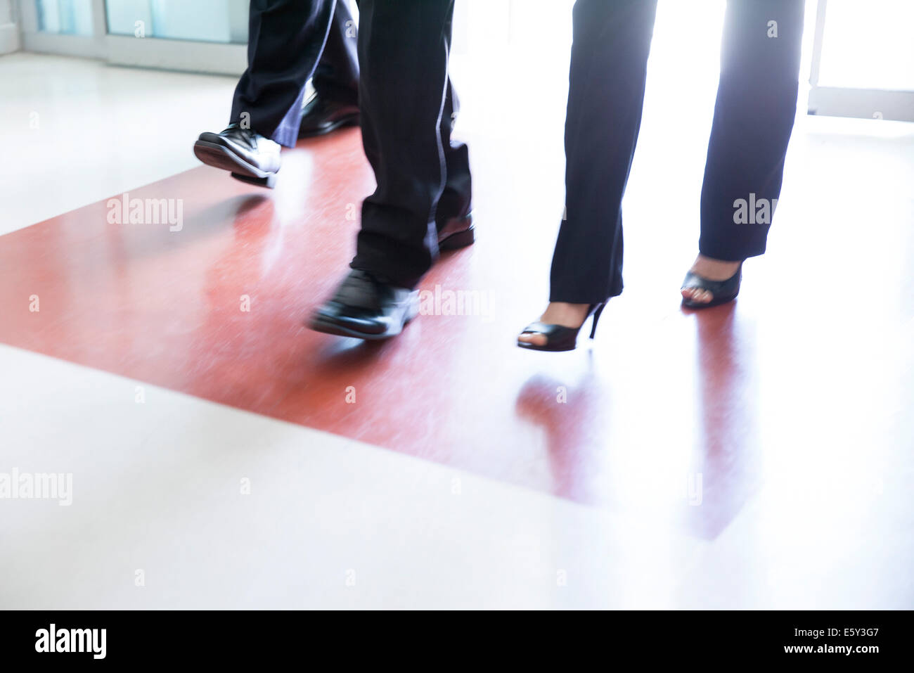 Business professionals entering building - Stock Image