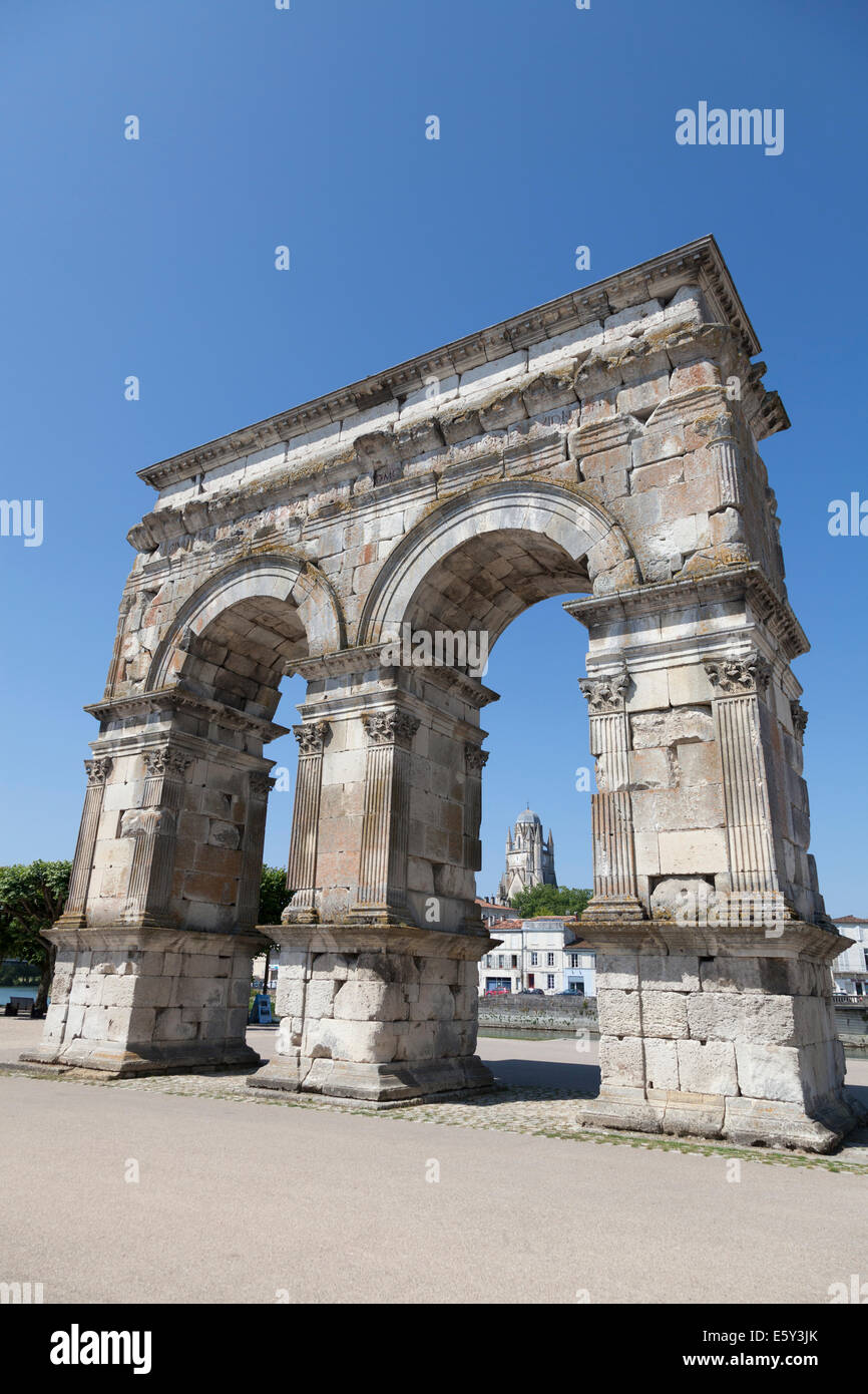Arch of Germanicus in Saintes with the Cathedral of Saint Peter. - Stock Image
