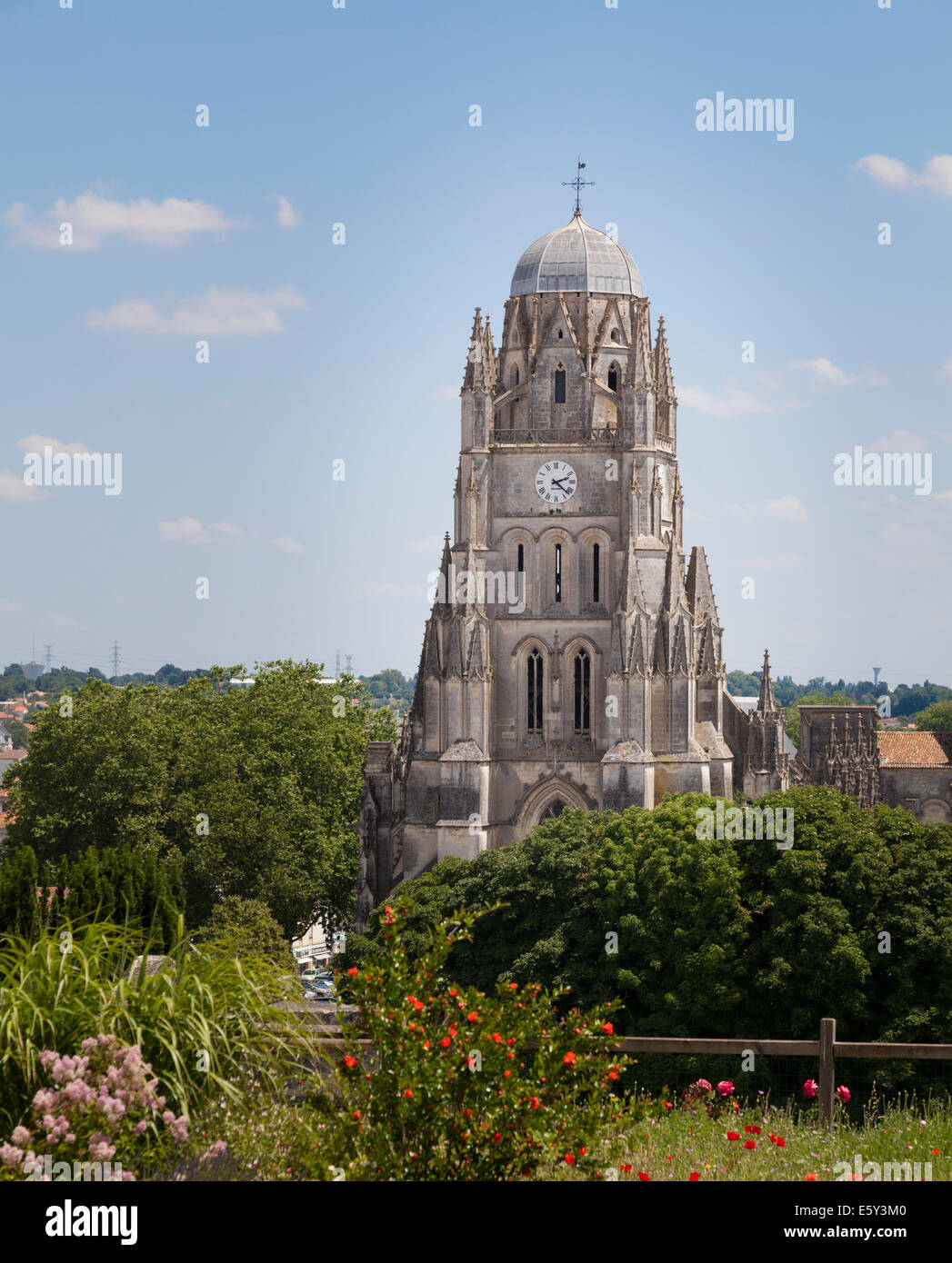 The Cathedral St Peter at Saintes seen over the roof tops. - Stock Image