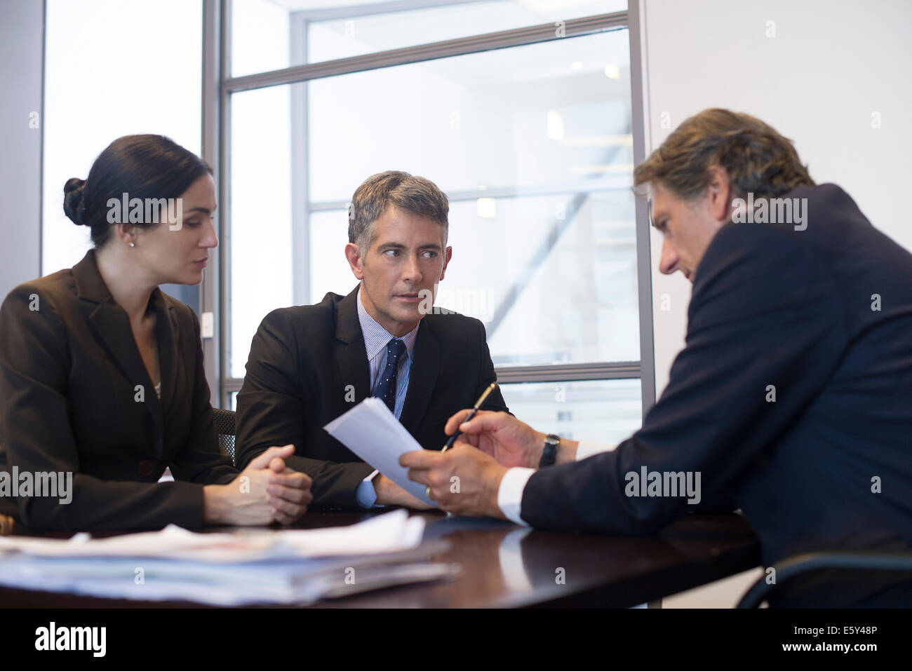 Business meeting, business associates reviewing document - Stock Image
