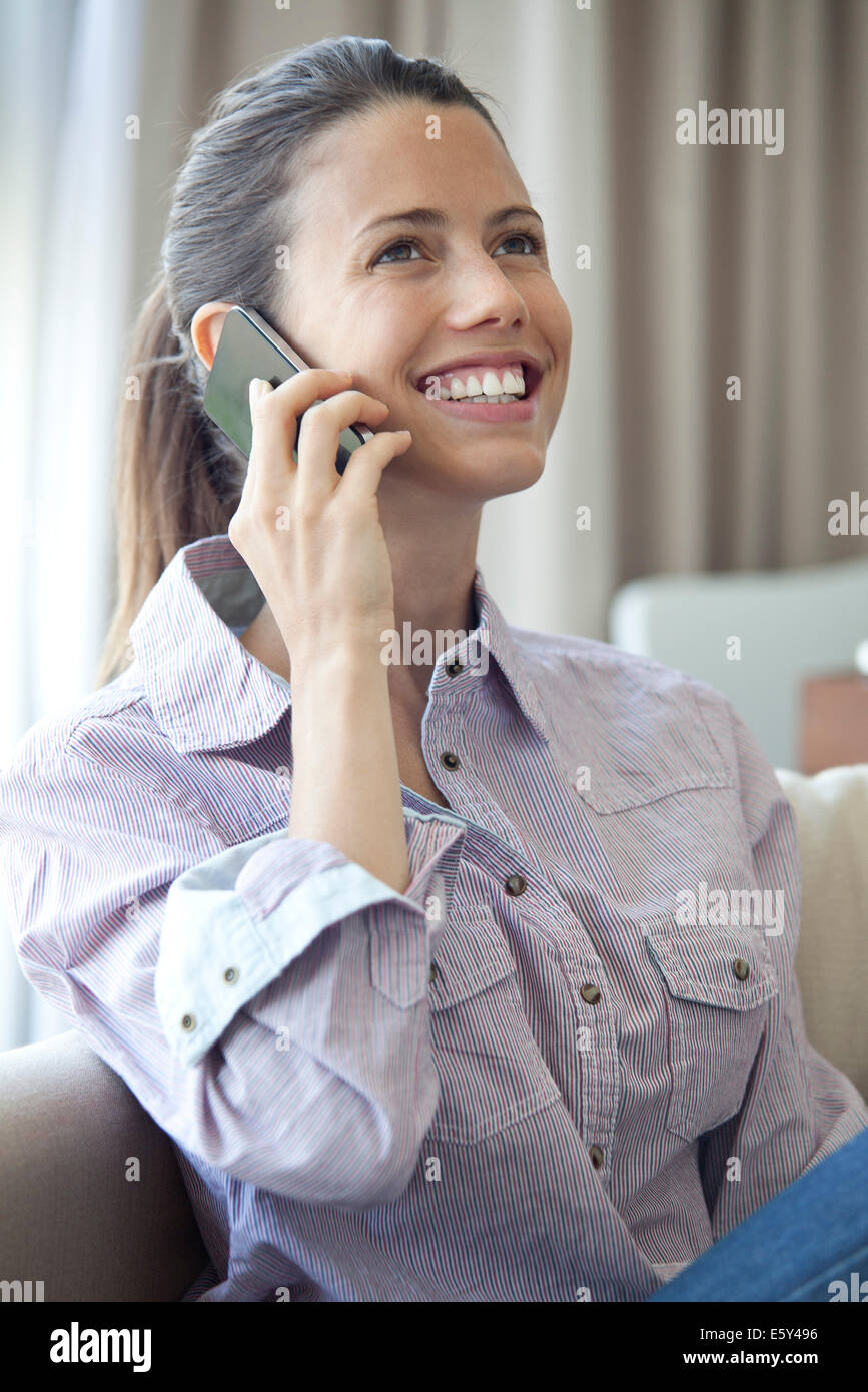 Good news arrives by telephone call - Stock Image