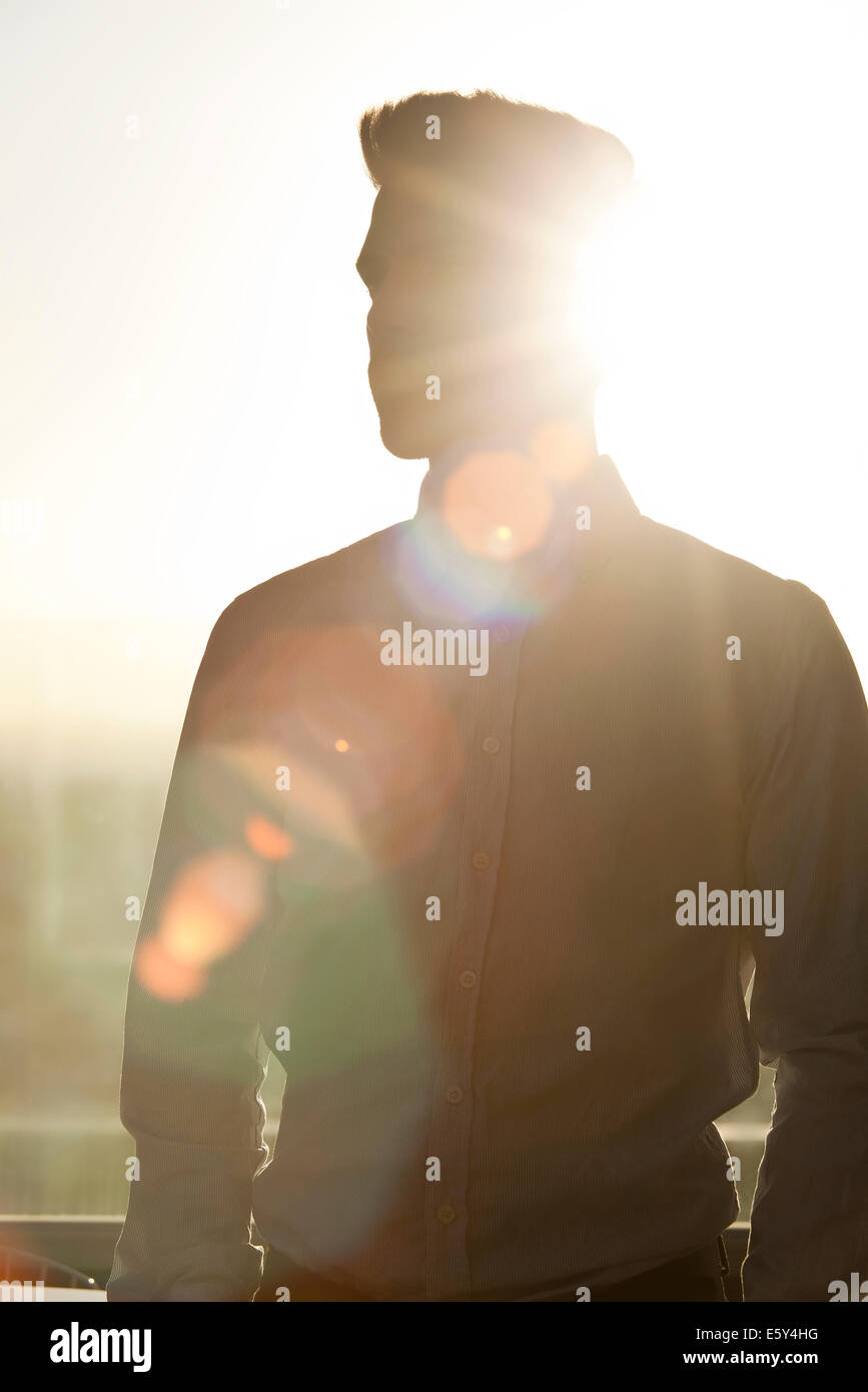 Young man, silhouette - Stock Image