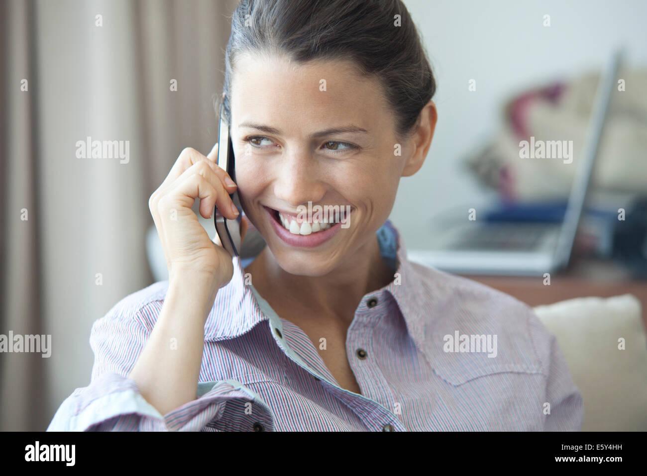 Woman enjoying cell phone conversation - Stock Image