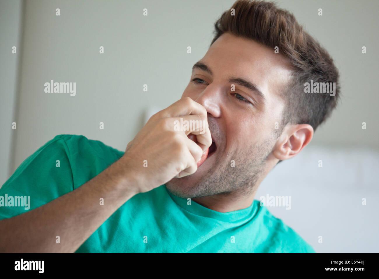Man eating apple - Stock Image