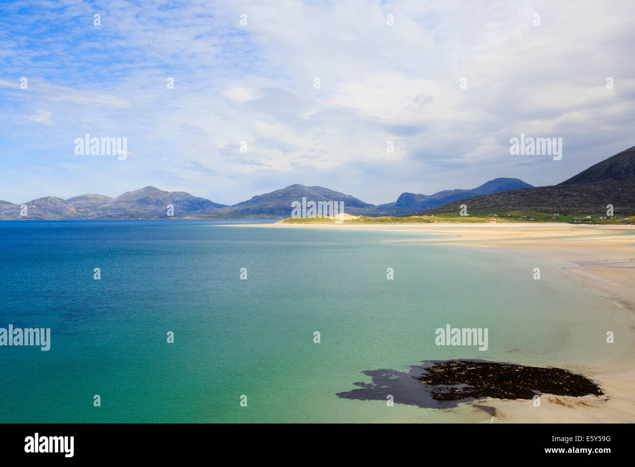 View across Sound of Taransay and Traigh Sheileboist beach to mountains of north Harris Outer Hebrides Western Isles Stock Photo