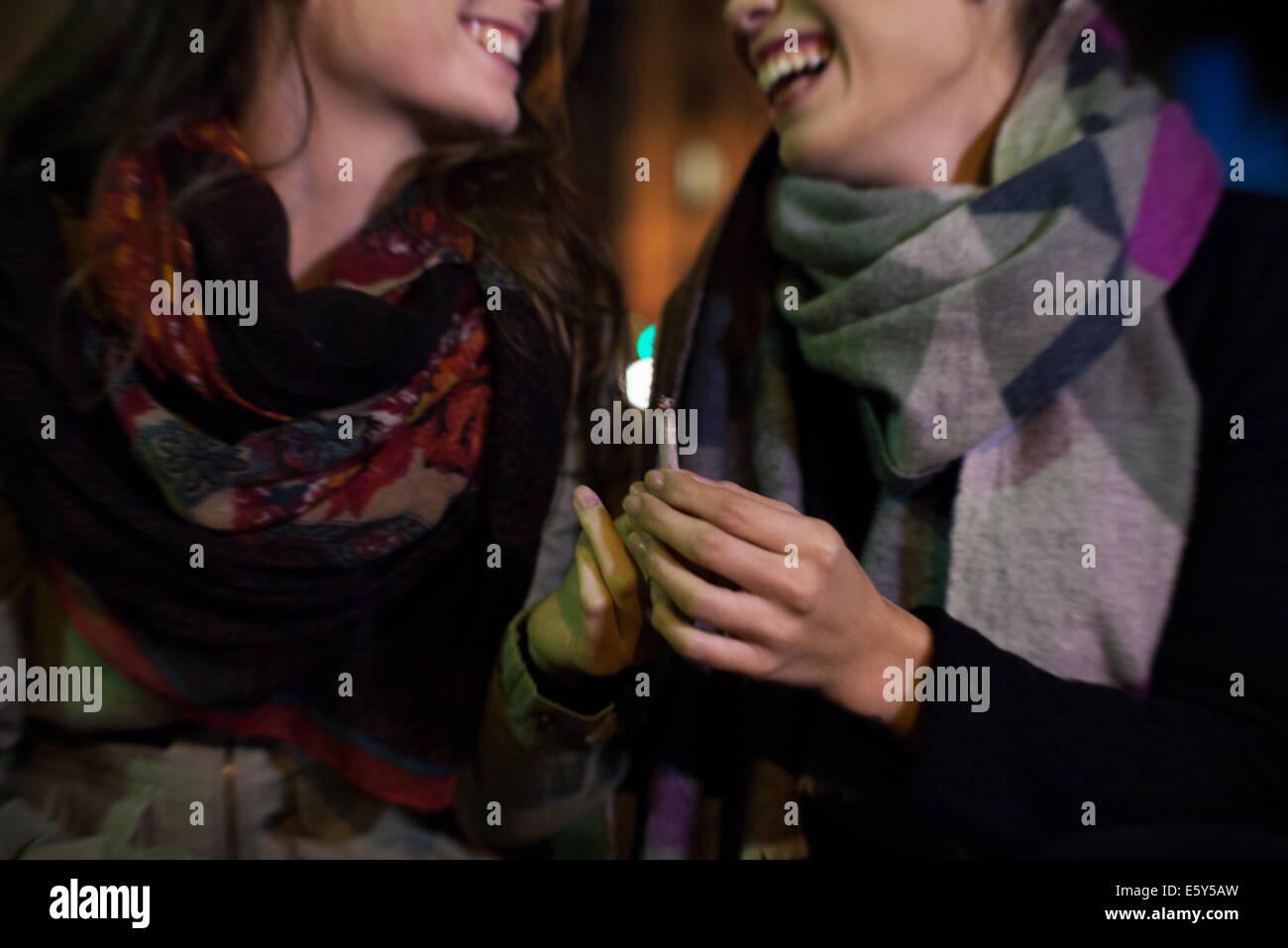 Friends bonding over cigarette - Stock Image