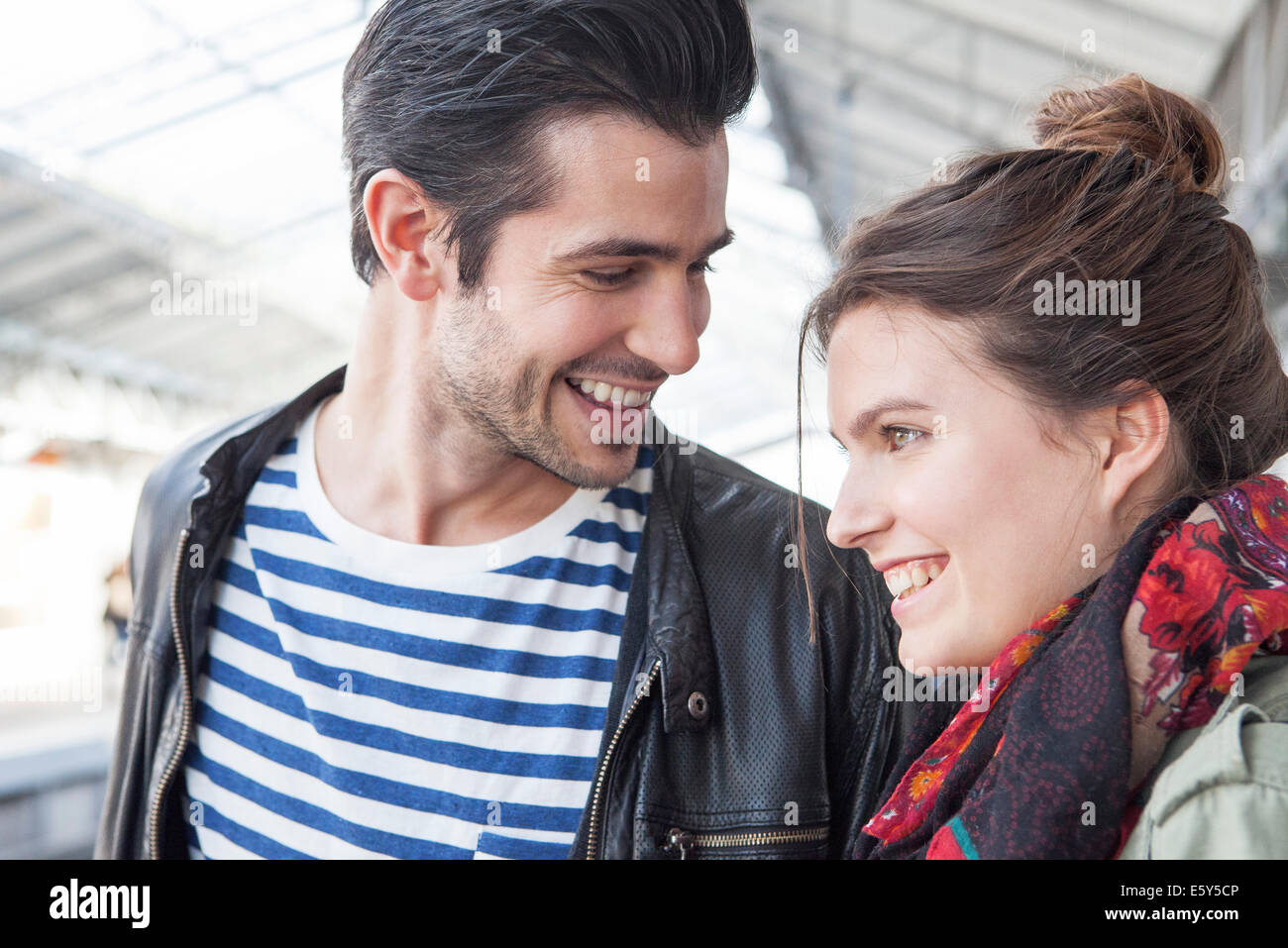 Young couple together on train platform - Stock Image