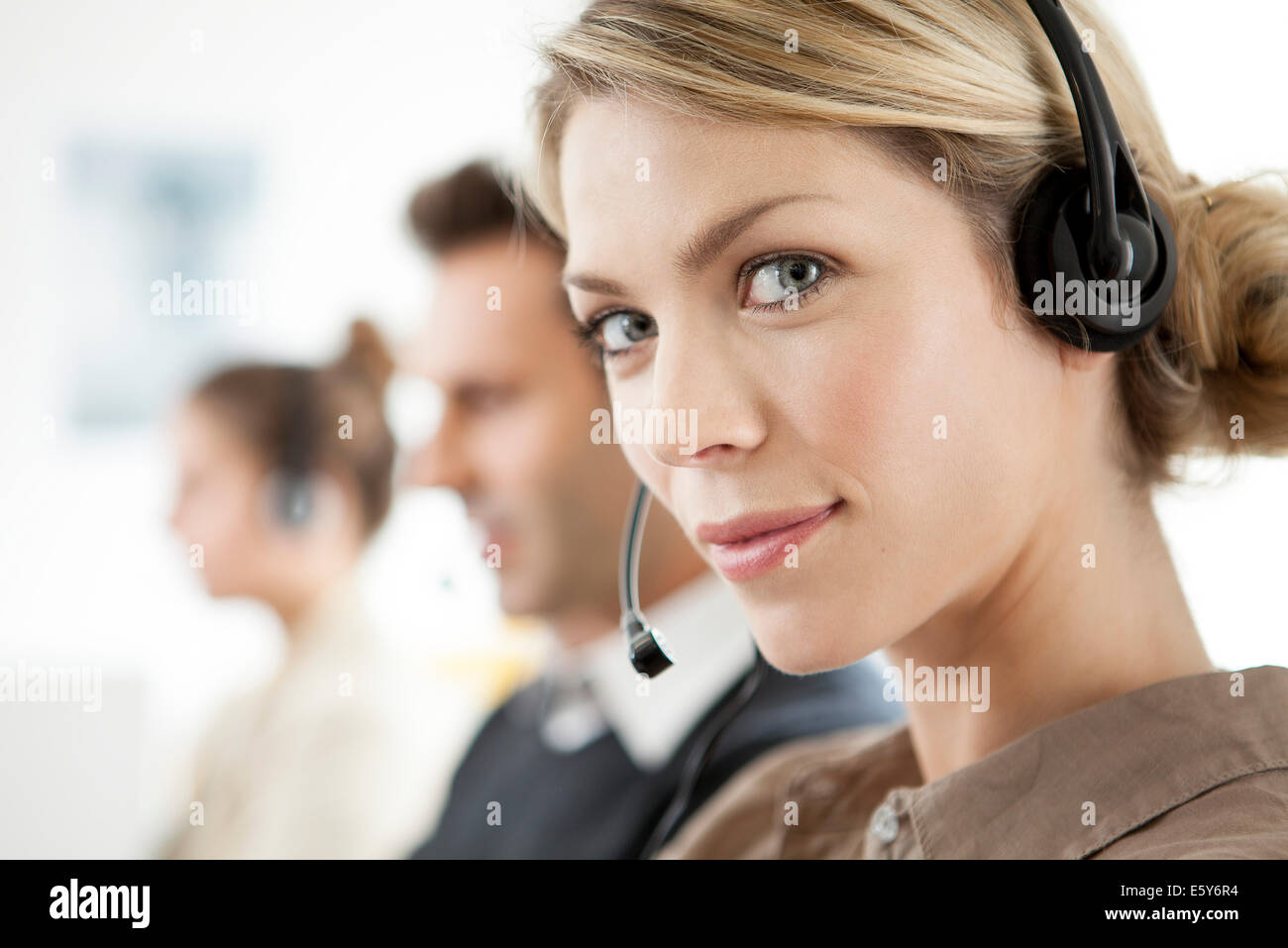 Telemarketer working in call center Stock Photo