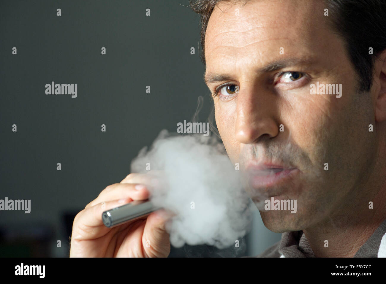 Man smoking electonic cigarette Stock Photo