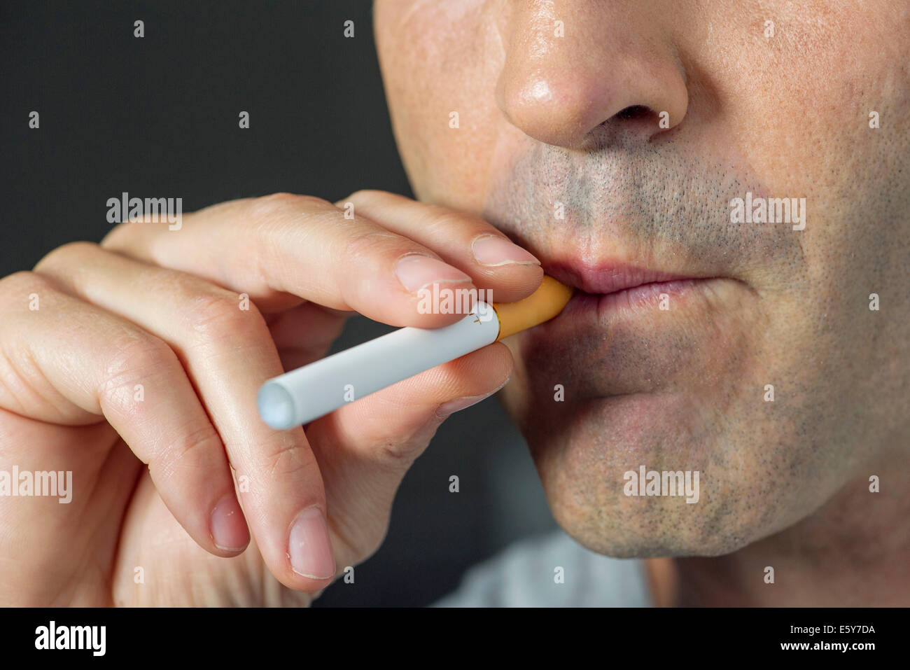 Man smoking electonic cigarette, cropped Stock Photo