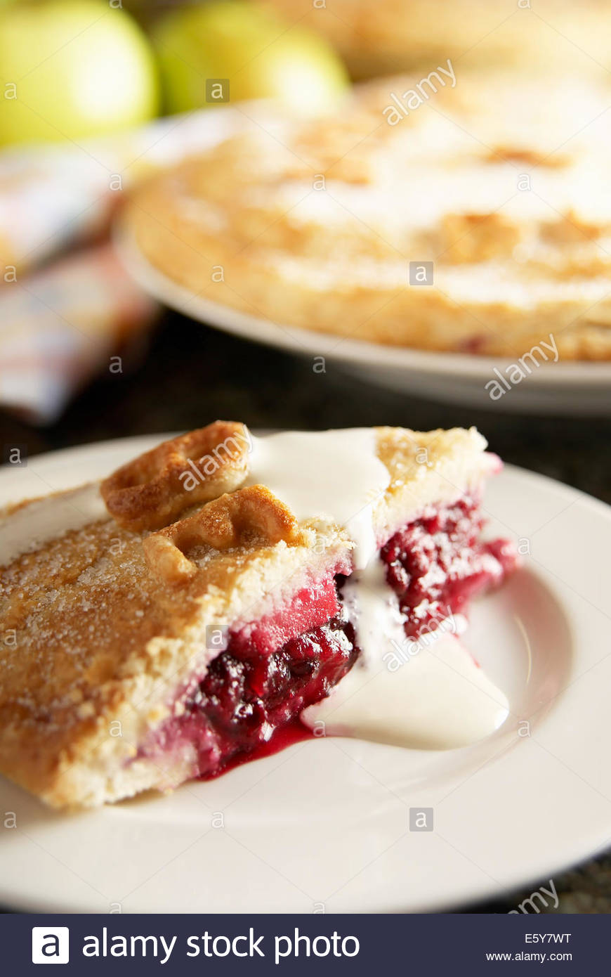 Homemade blackberry and apple pie. Made with homegrown apples and wild blackberries from England. Serving with fresh - Stock Image