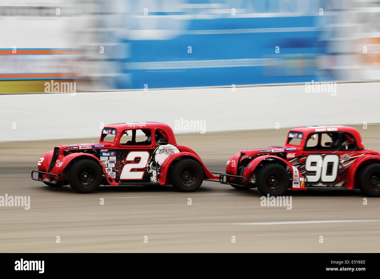 Motor racing at the Auto Clearing Motor Speedway racing circuit in Saskatoon, Saskatchewan, Canada. - Stock Image